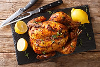 Homemade chicken rotisserie with thyme,