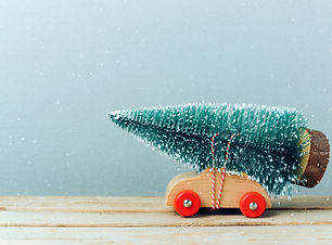 Christmas tree on toy car. Christmas hol