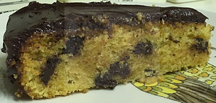 Gluten-free dairy-free egg-free vegan-friendly vanilla cake with dairy free and vegan friendly dark chocolate frosting and chocolate chips