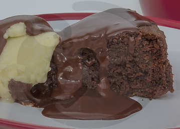Gluten-free dairy-free egg-free vegan-friendly chocolate cake with dairy-free vegan-friendly ice cream and dairy-free vegan-friendly chocolate sauce