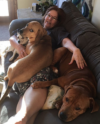 Bobbi Dubins with her foster dogs