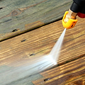 Pressure washing cleaning decks, patios, driveways