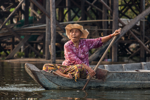 Woman transporting herself in her floating village.
