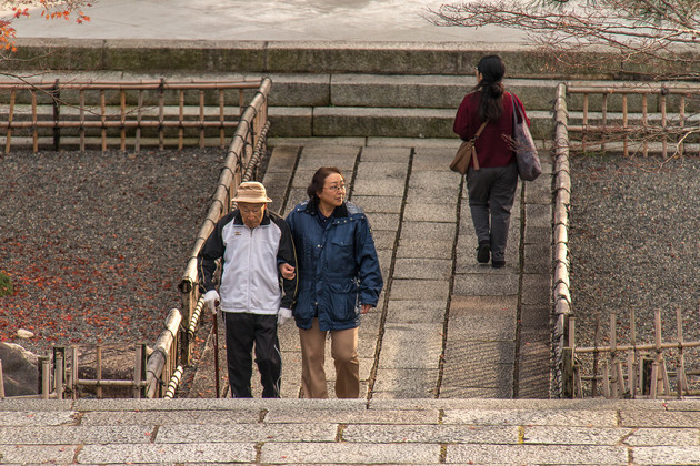 Two people walking in Kyoto, Japan.