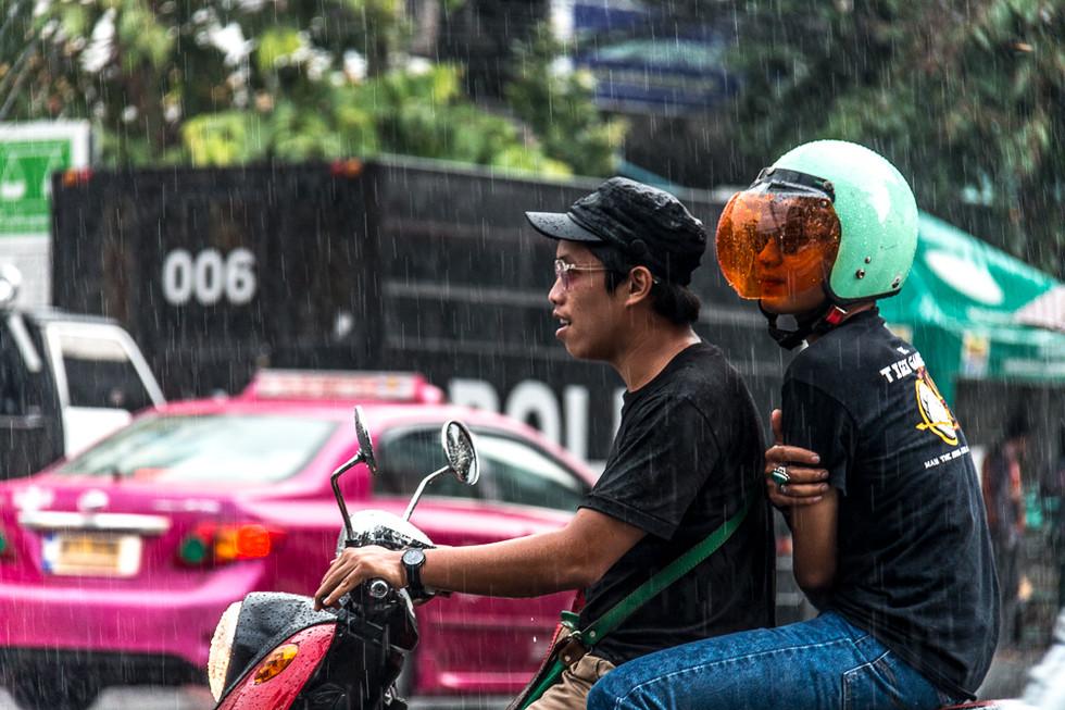 Dos mens in motocycle around Bangkok, Thailand.