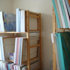 Shelves of finished paintings.