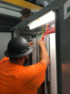 Electrician working in panel