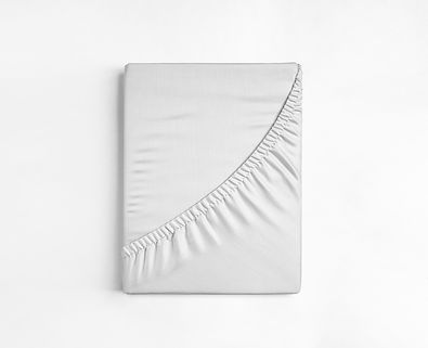 Flat sheet or bed cover folded. White fitted sheet against a white background. White sheet