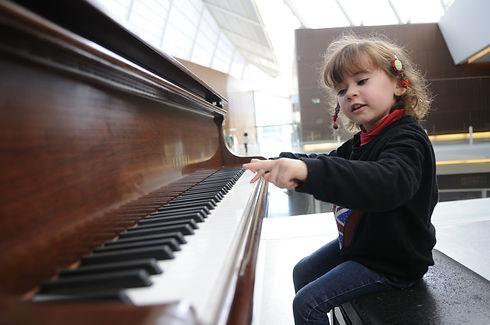 adorable-little-girl-having-fun-playing-the-piano.jpg