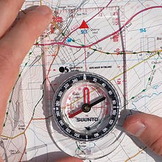 Using a compass on an ordnance survey map