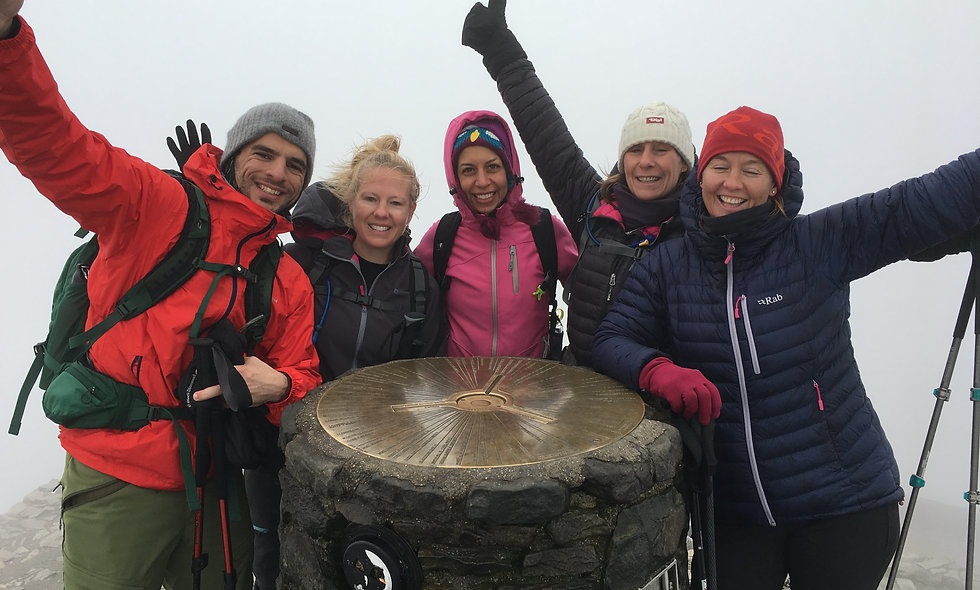 Group of hikers from London celebrating completing the three peaks challenge on Snowdon