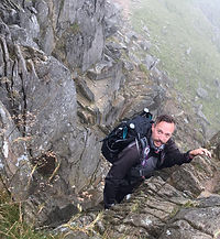 City Mountaineering guide Nathan Heywood scrambling in Lake District