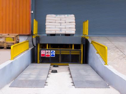 Loading dock leveler ramp outside wareho