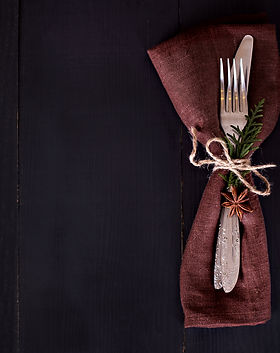 Table setting. Dark photo, brown napkin