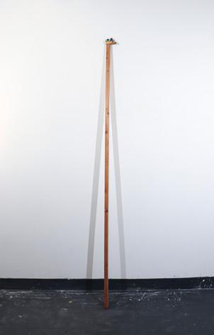 "Mike Marrella. Untitled. Oil on found wood. 1 ½ x 1 ½ x 60"". 2018."