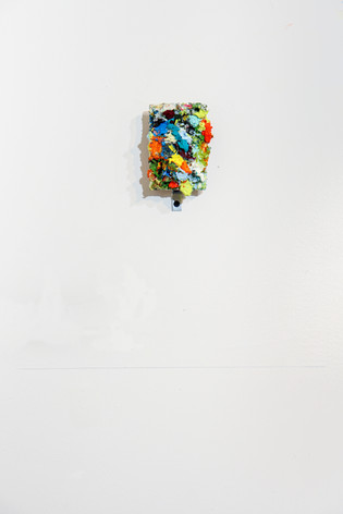 """Mike Marrella. Untitled. Oil on plywood with L bracket and pencil line on wall. 3 ½ x4 ½"""". 2018."""