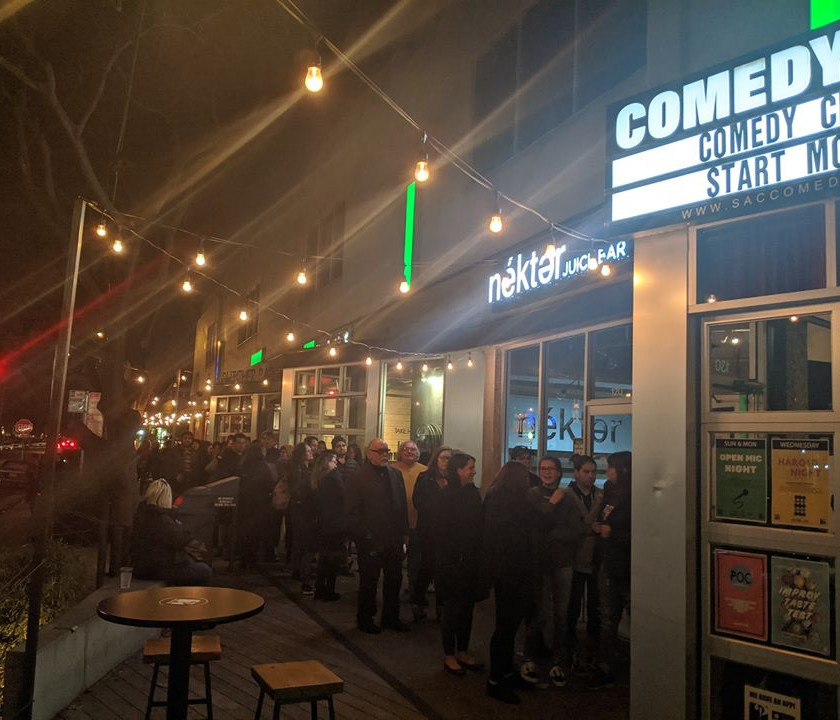 The outside of the Sacramento Comedy Spot, with a long line of people excited to see the show
