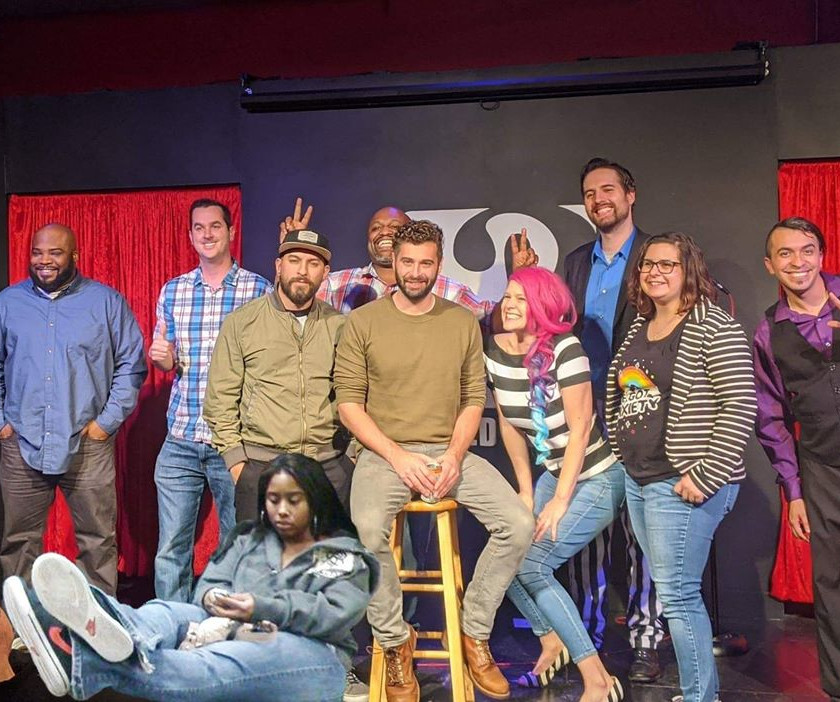 The comedians, producers, and ASL interpreter at the January 19 show at Sacramento Comedy Spot. From left: Dejan Tyler, Robert Vogel, Nick Larson, Leggs Malone, Mike Cella, Aliada (producer), Drew Kimzey (producer), Emily Pedersen, Mark Medina (ASL interpreter from Signs of Pride), K Britney Davis (bottom of photo, digitally added)