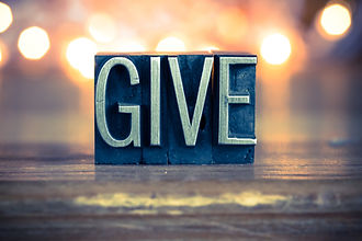 The word GIVE written in vintage metal l
