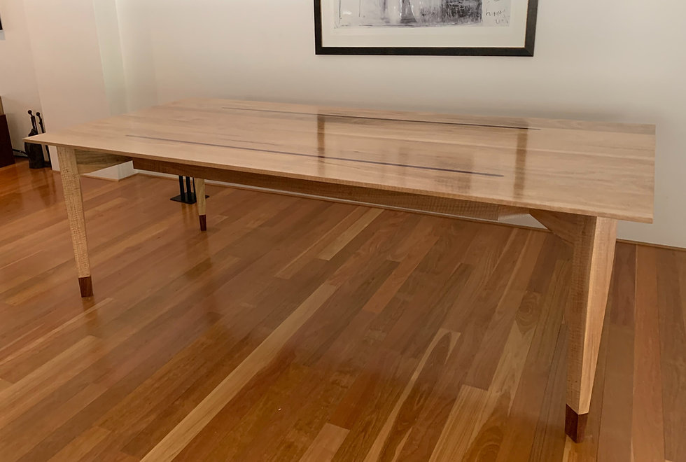 Marri dining table with Banksia inlay to top and socks to bottom of table legs sock