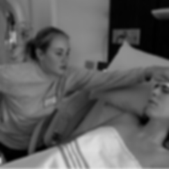 Hypno Doula using the Hypnobabies Relax Cue on a mom's forhead during labor