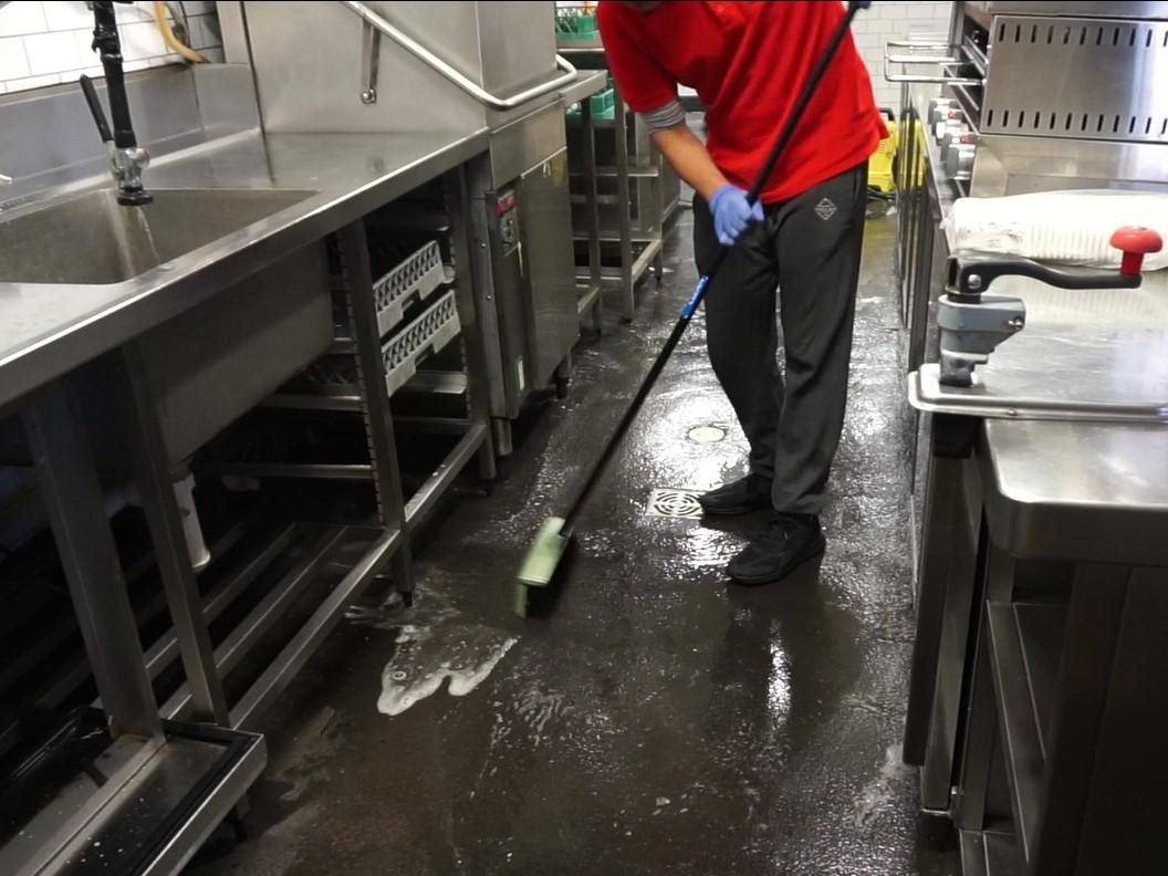 sweeping floor of kitchen