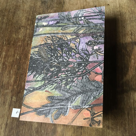 SOLD .... Front of blank notebook. Hand printed covers embellished by hand with coloured pencil (£24)
