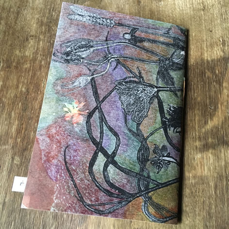 SOLD .... Back of blank notebook. Hand printed covers embellished by hand with coloured pencil (£24)
