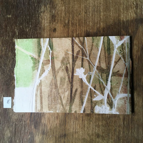 SOLD:  Back of small notebook with hand printed covers (£10)