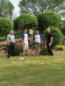 Kevin and employees of Phillips Medisize choosing placement of nest boxes for Bluebird Trail