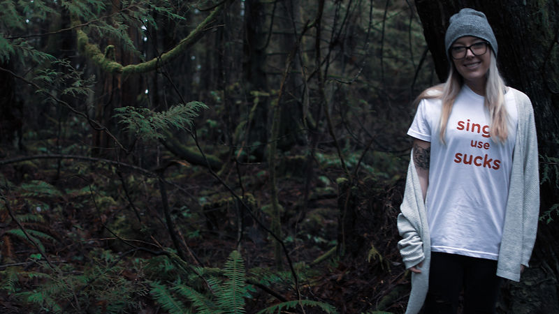 Photograph of author, Brittany Leonard, standing in the forest.
