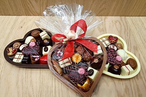 Chocolade hart gevuld met pralines.