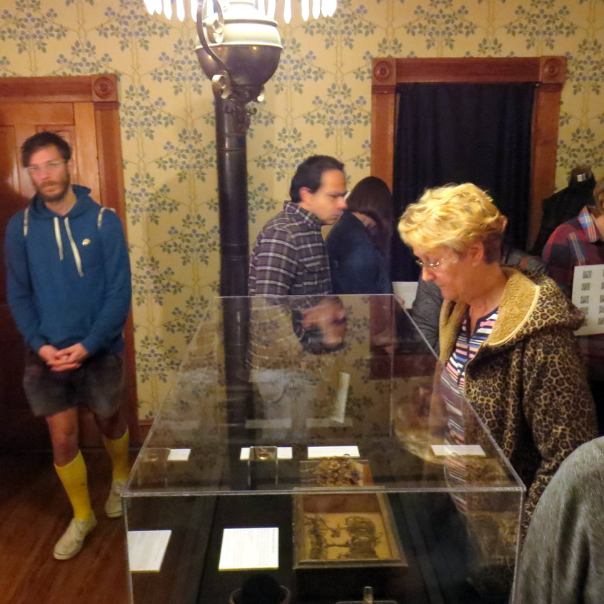 Visitors look at exhibit