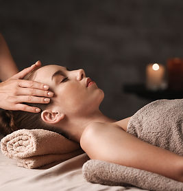 Young woman having massage in spa salon.