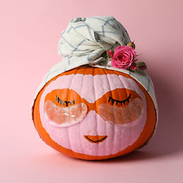 Pumpkin with eye patches and towel on pink background.jpg