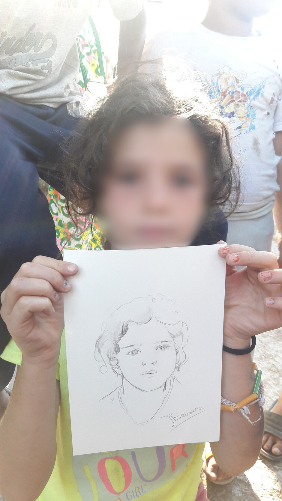 Aziz draws portraits of the kids in The Vesely Refugee Camp
