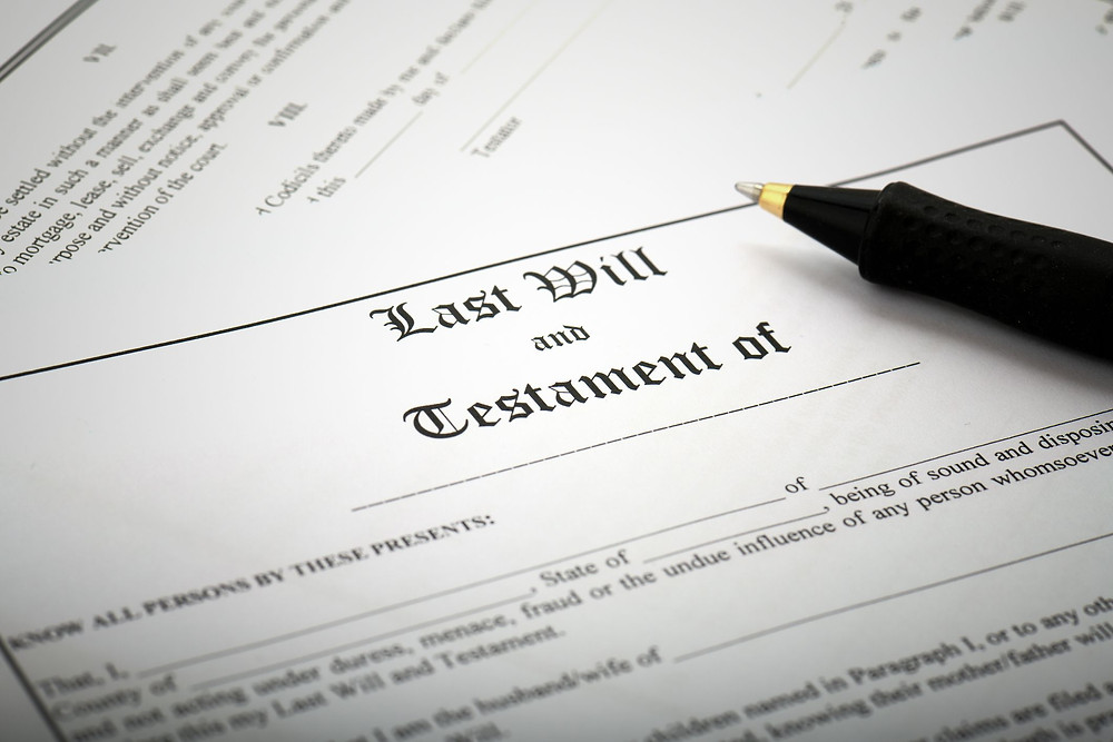 Last will and testament document with black pen and black text