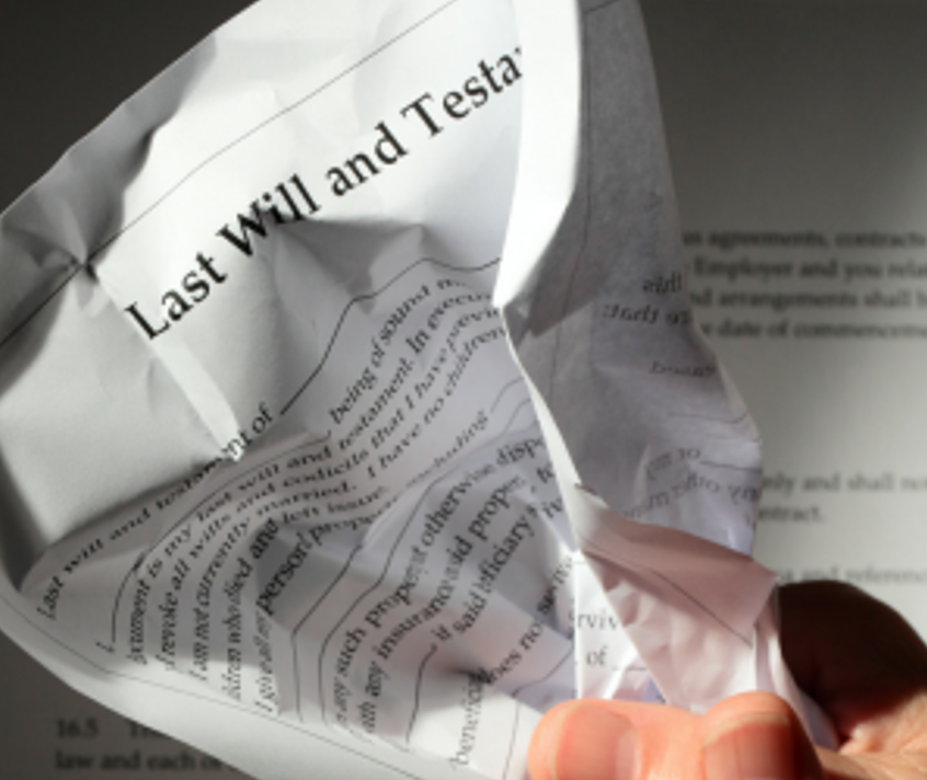 last will and testament crumpled in hand