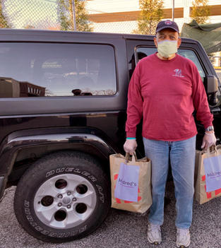 Chairman, Board of Director Helping with Food Distribution
