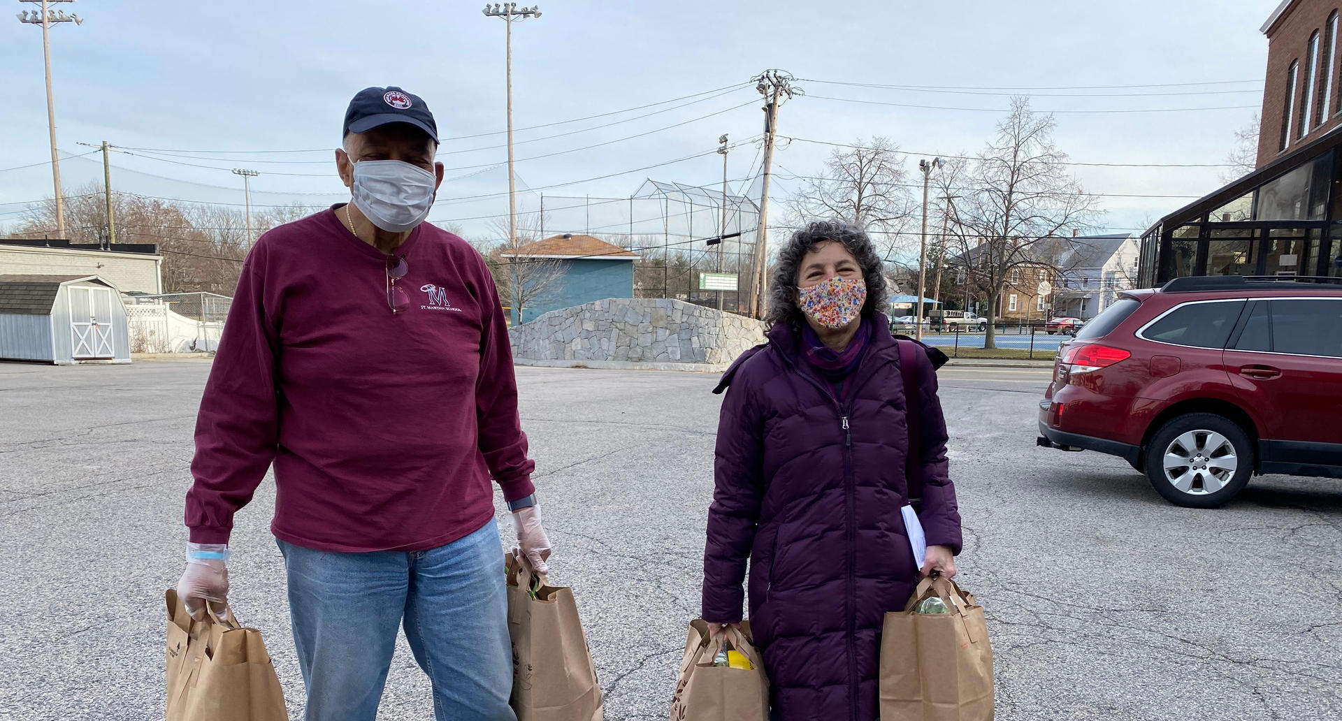 Board of Directors Helping with Food Distribution