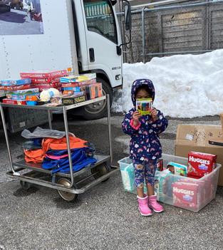 Child Receiving Books