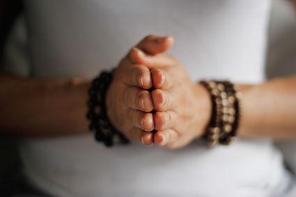 _Woman hand yoga pose. Practicing medita