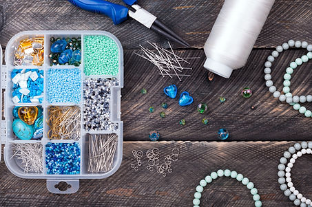 Box with beads and pins, spool of thread