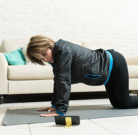 Active elderly female learning cow pose