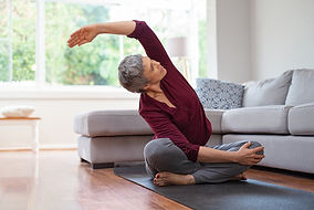 Senior woman exercising while sitting in