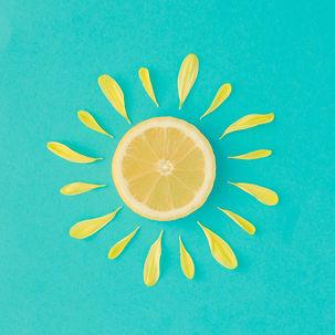 Sun made of lemon and yellow flower peta