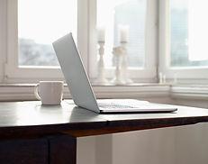 Laptop Open On Desk, Ready For Online Meditation Event