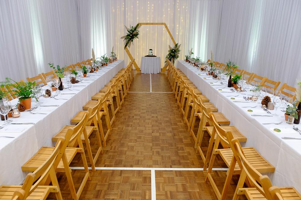 beautiful village hall wedding long tables