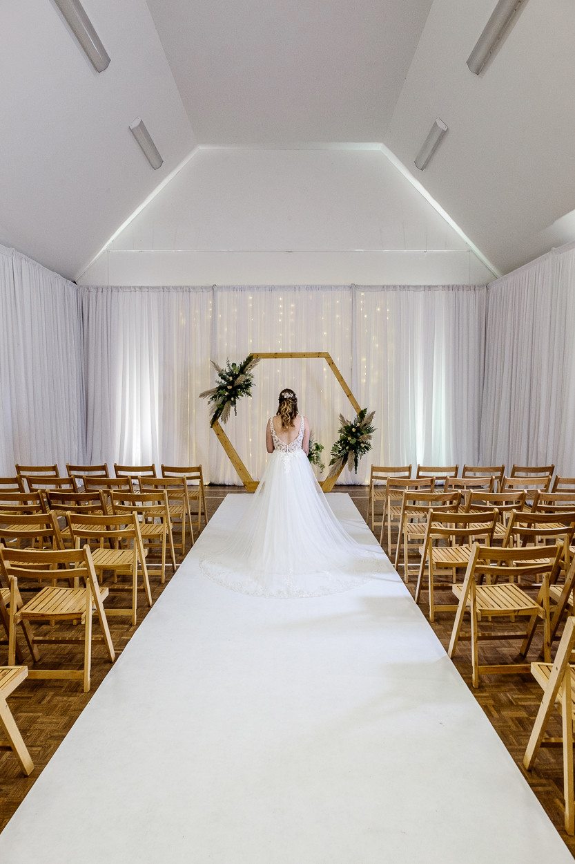 Village hall wedding with lined walls and beautiful bride