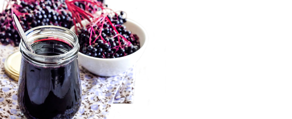 Homemade black elderberry syrup in glass